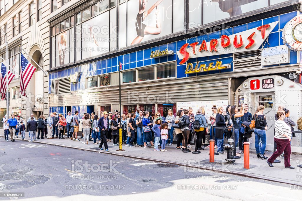Manhattan NYC buildings of midtown Times Square, Broadway street avenue road, sign, long line queue of people crowd waiting for restaurant food called Ellen's Stardust Diner stock photo