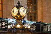 New York, USA - Jan 13, 2016: A clock and departure signs mid day at Grand Central Station.