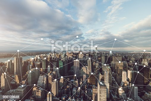 istock Manhattan Skyline and Blockchain Concept 956109648