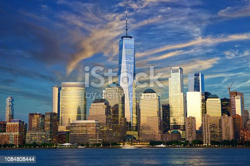New York City financial district over Hudson River at dusk