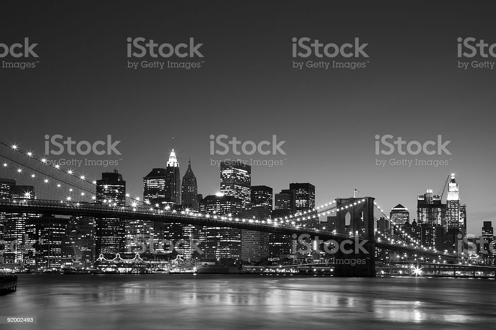 manhattan skyline at dusk with brooklyn bridge in front back&white royalty-free stock photo