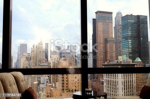 Manhattan Skyline from a window, NYC.