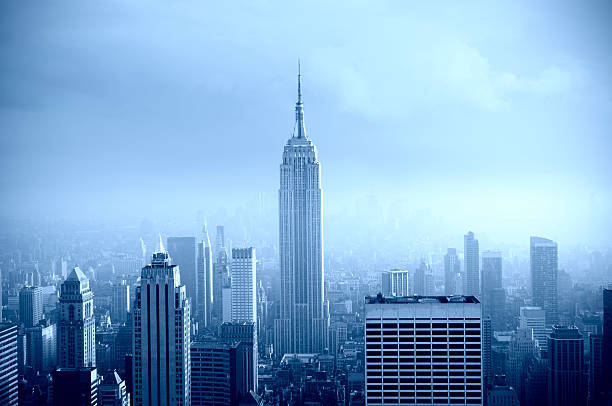 Manhattan Skyline in the Fog, NYC. Blue Toned.
