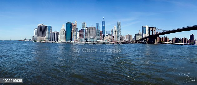 Manhattan, New York with Brooklyn Bridge seen from Hudson River on a  bright summrs day.
