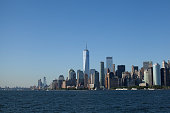 Manhattan skyline, New York seen from Hudson River on a summer day.