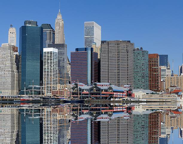 Manhattan Skyline Dramatic Skyline of Manhattan Island in New York CIty south street seaport stock pictures, royalty-free photos & images