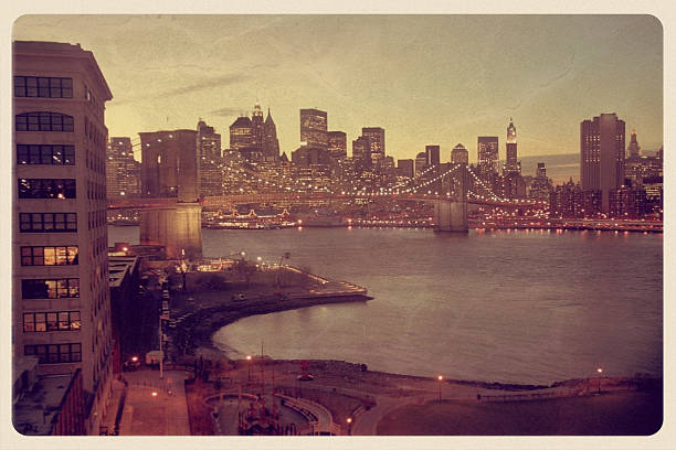 Manhattan Skyline Postcard - Grunge Retro-styled postcard of southern Manhattan an night. south street seaport stock pictures, royalty-free photos & images