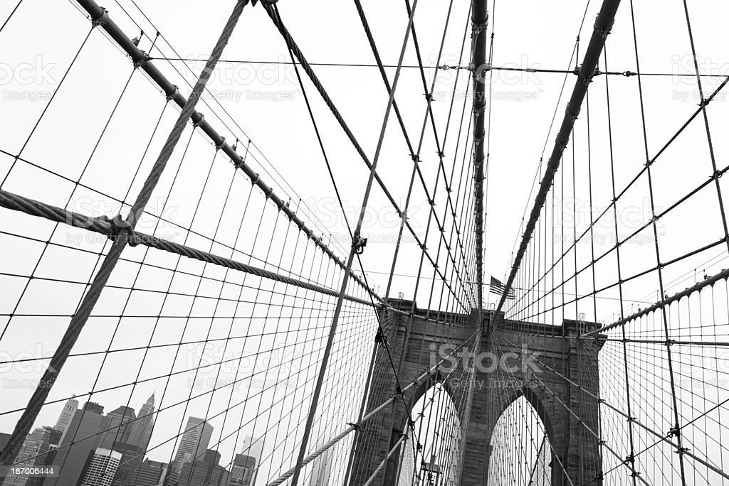 Manhattan skyline though the wires of the Brooklyn Bridge royalty-free stock photo