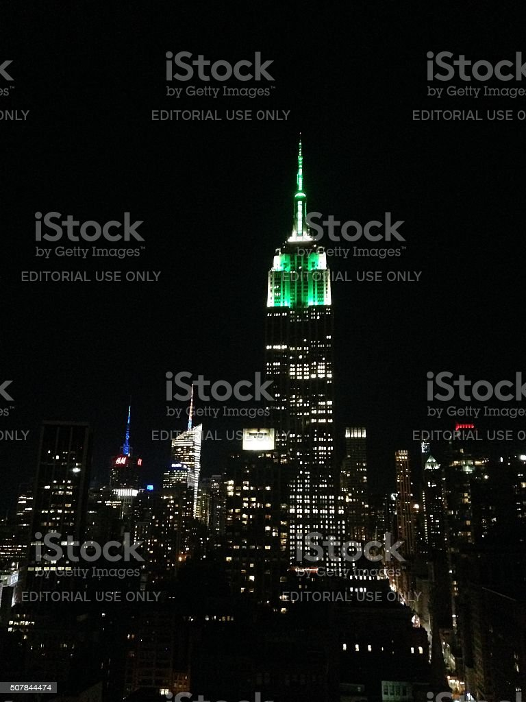 Manhattan Skyline with Empire State Building at Night. stock photo