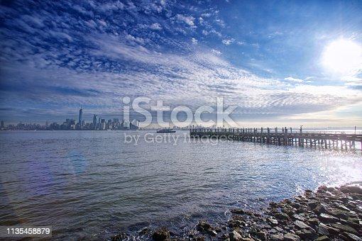 910867946 istock photo Manhattan Skyline with jetty 1135458879