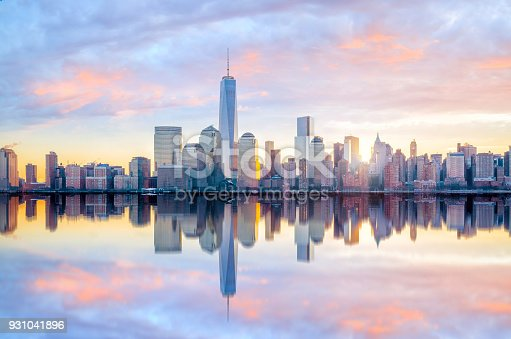 istock Manhattan Skyline with the One World Trade Center building at twilight 931041896