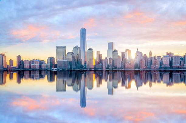 Manhattan Skyline with the One World Trade Center building at twilight Manhattan Skyline  at twilight, New York City new york state stock pictures, royalty-free photos & images