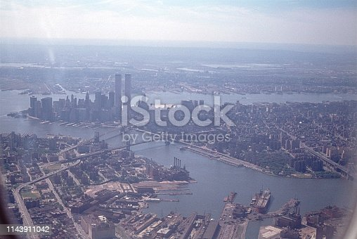 New York City, NY, USA, 1977. Manhattan, the East River and Brooklyn seen from an airplane window.