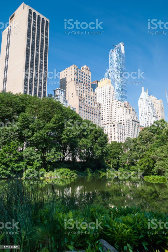 Manhattan towers emerging over Central Park stock photo