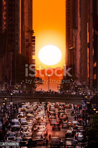 Manhattanhenge in New York City, along the 42nd street. Manhattanhenge is an event during which the setting sun is aligned with the main street grid of Manhattan, New York City
