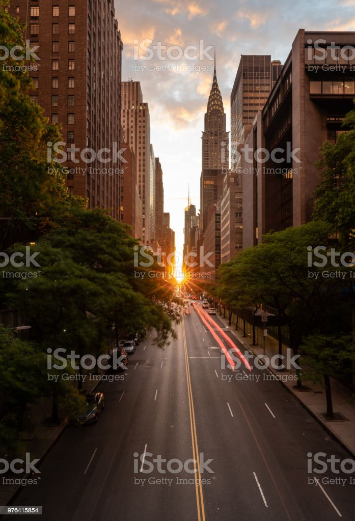 Manhattanhenge when the sun sets along 42nd street in NY stock photo