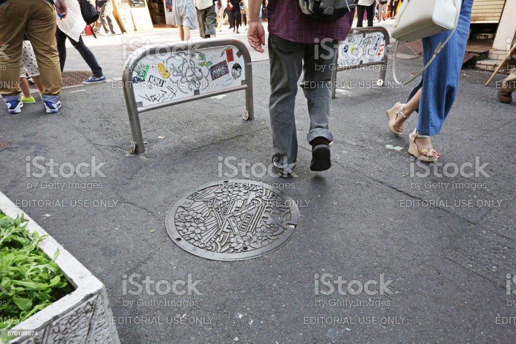 Manhole Cover in Osaka Namba, Japan in Springtime stock photo