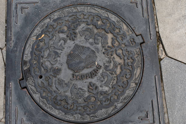 Manhole cover in zaryadye park a castiron round graceful manhole picture id1280801926?b=1&k=6&m=1280801926&s=612x612&w=0&h=7yj1mumjm3cm3a4syslr ox9l03hn9wobopi21jna6a=