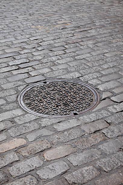 Manhole Cover On Street stock photo