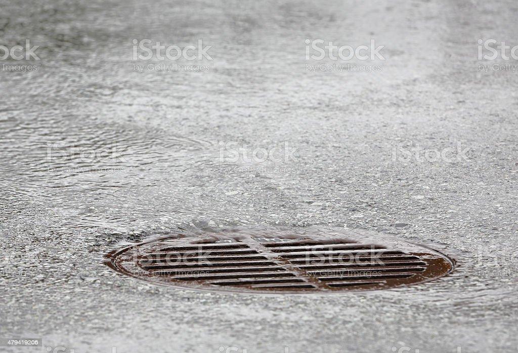 Manhole Grate, Heavy Rain stock photo