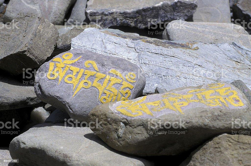 Mani rocks in Tibet royalty-free stock photo