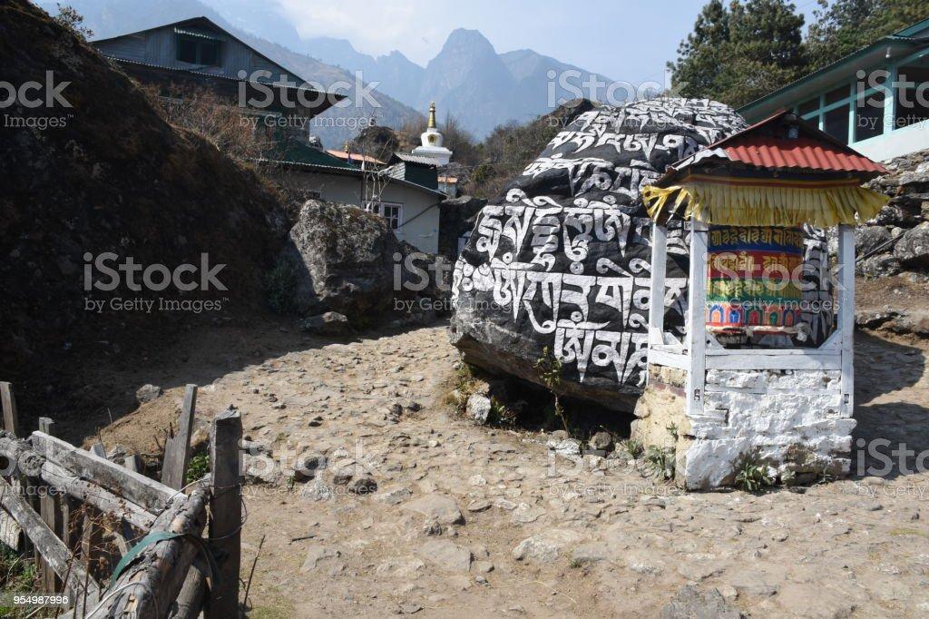 Mani stone and praying weel in Nachipang, Nepal stock photo