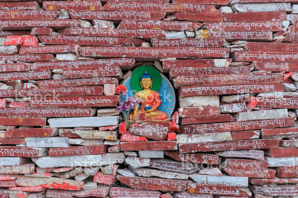 Mani stones with buddhist mantra Om Mani Padme Hum engraved in Tibetan in Yushu, China stock photo