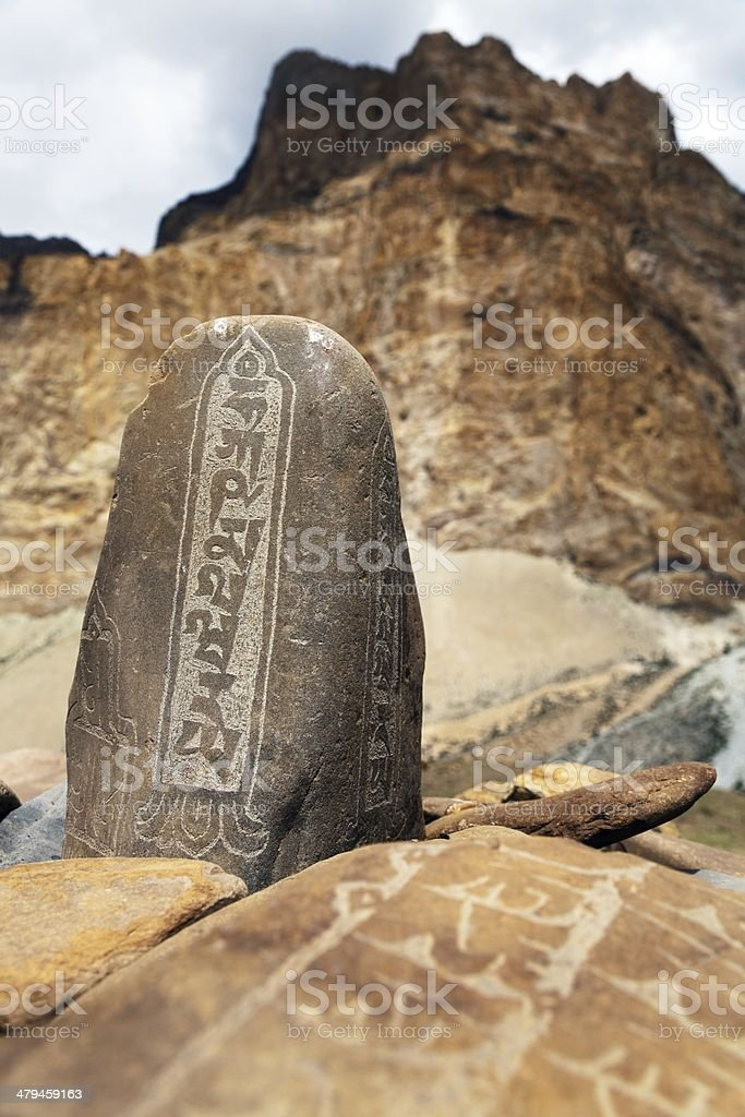 Mani wall and stone with buddhist symbols stock photo