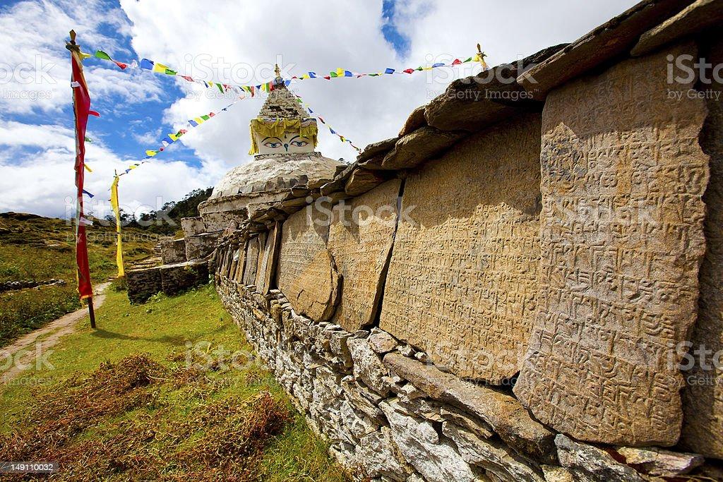 Mani wall in Himalaya mountains stock photo