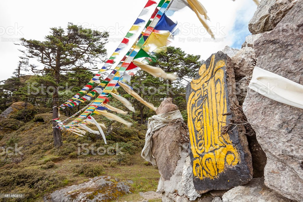 Mani wall - traditional religious landmark in nepalese Himalayas stock photo