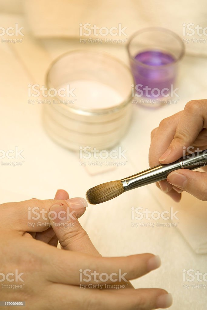 Manicure Applying Artificial Nail royalty-free stock photo