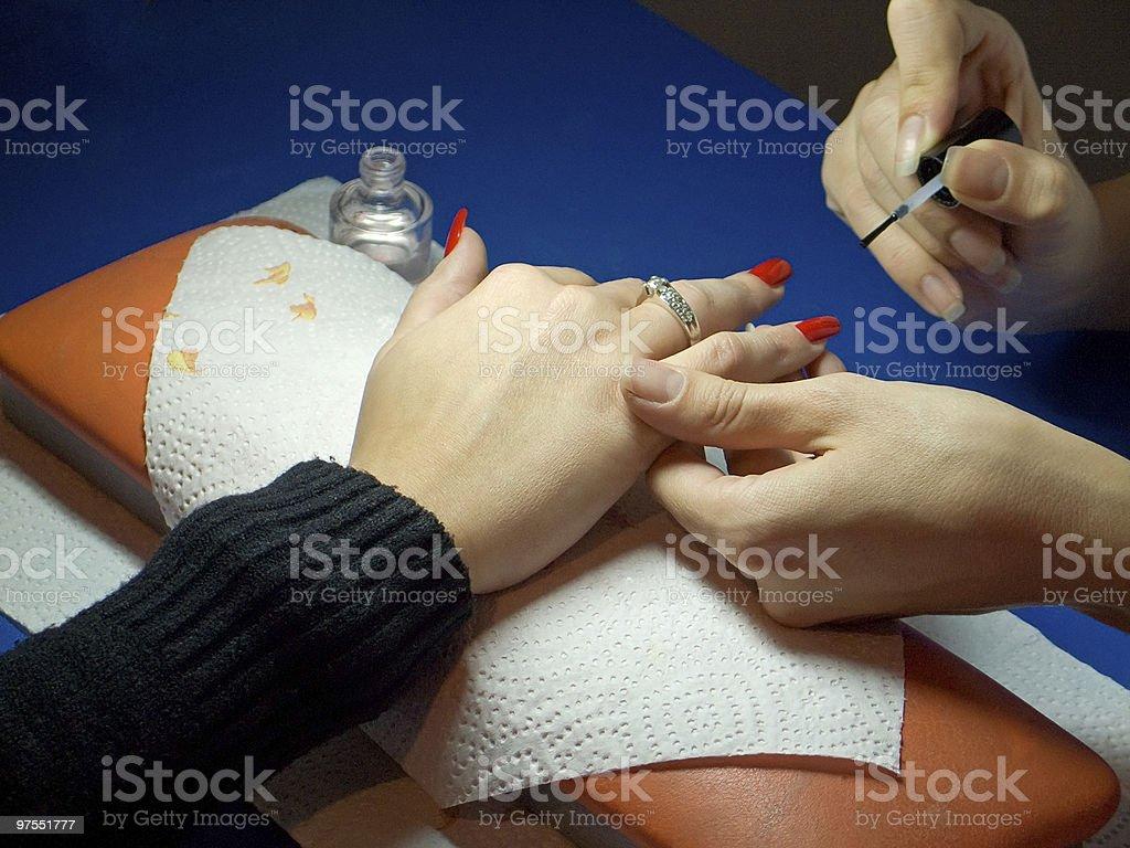 Manicure doing nail polish royalty-free stock photo