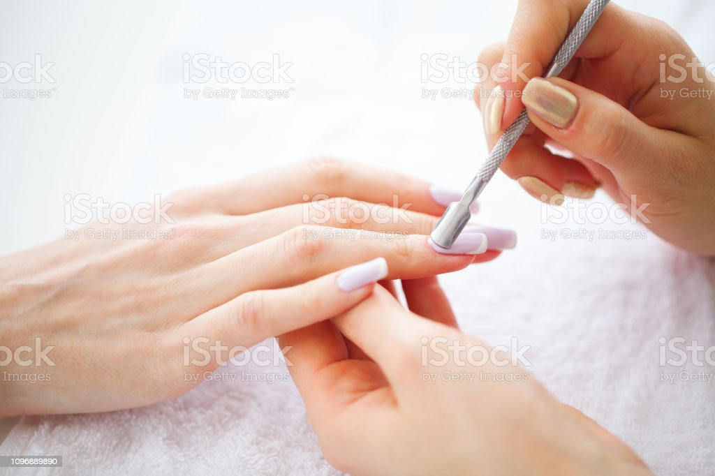 SPA manicure. French manicure at spa salon. Woman hands in a nail...