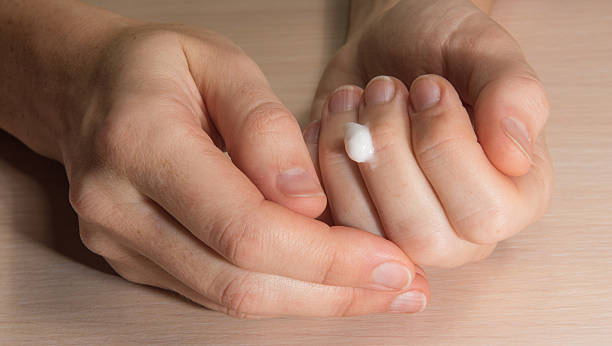 manicure in home conditions - cuticle stock pictures, royalty-free photos & images