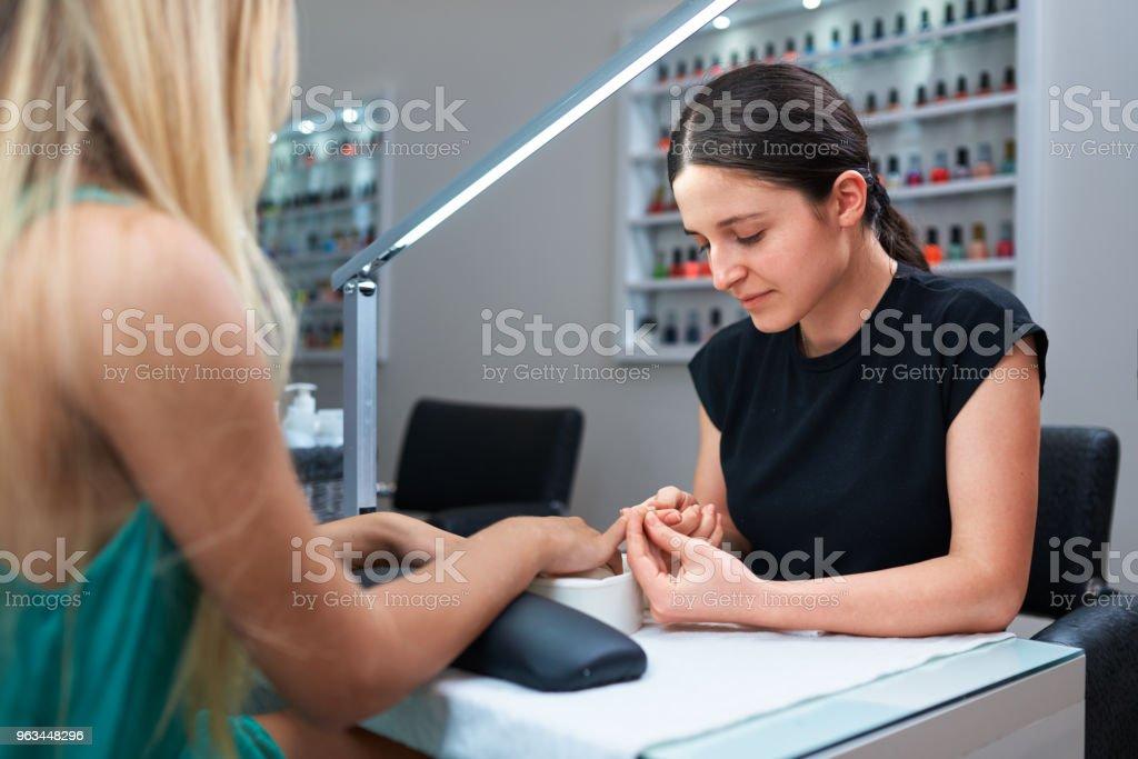 manicure nail care for the client - Zbiór zdjęć royalty-free (Biuro)
