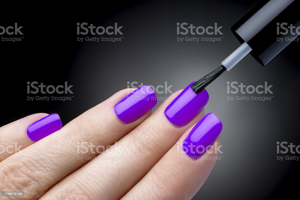 Manicure Of Womans Long Fingernails With Purple Nail Polish Stock ...