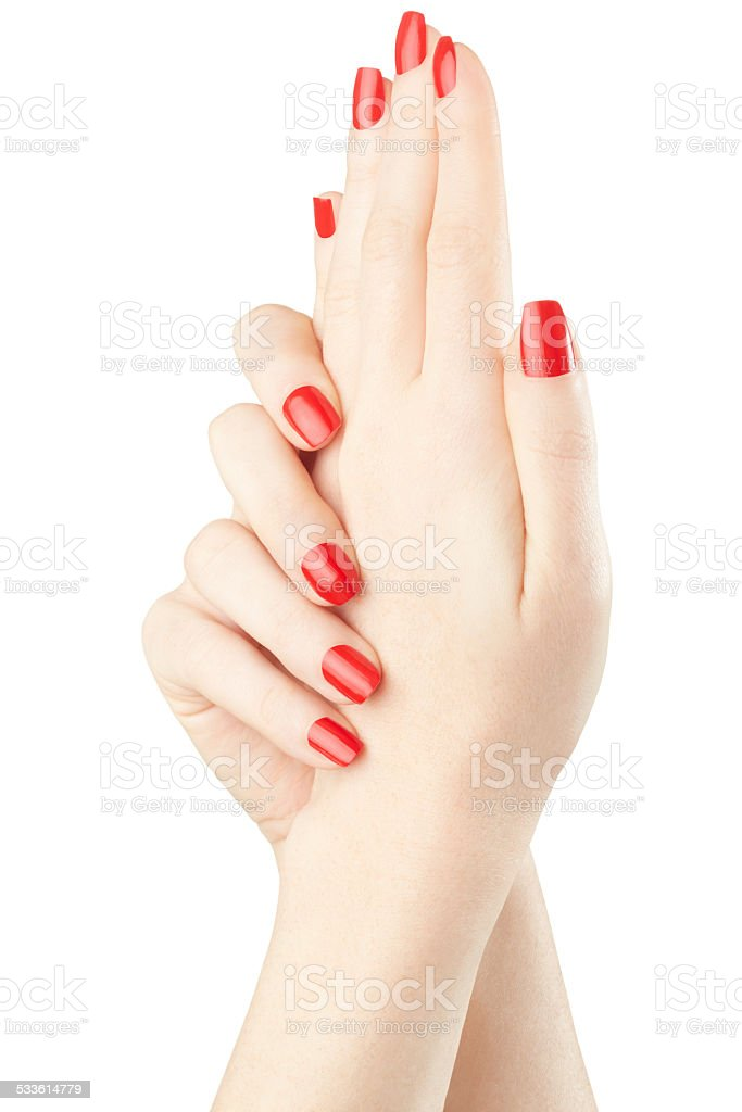 Manicure on female hands with red nail polish stock photo