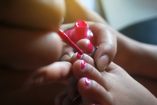 istock Manicure, paint nails. 1184507655