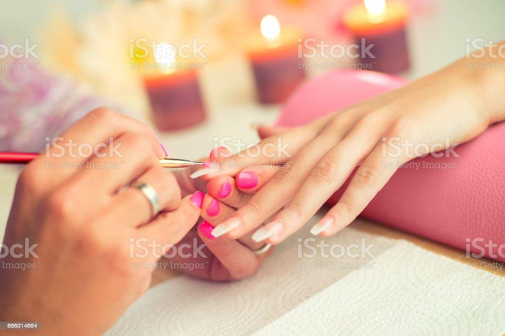 Manicure process in a beauty salon stock photo