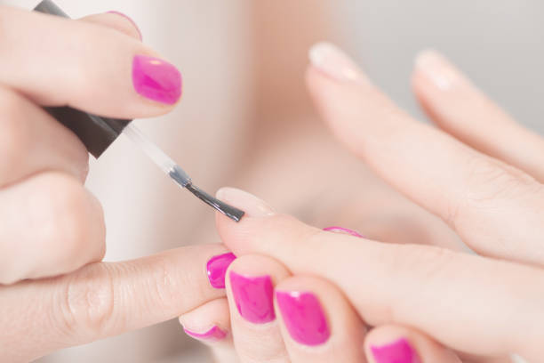 manicure process in a beauty salon - tamara dragovic stock photos and pictures