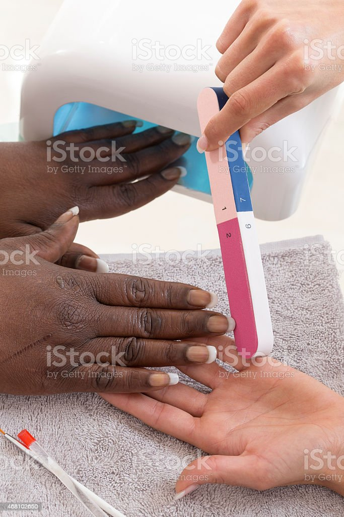 Manicure process in beauty salon, close up stock photo