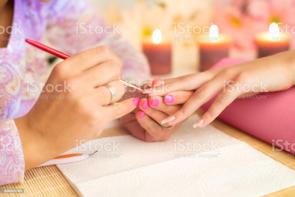 Manicure process in beauty salon stock photo