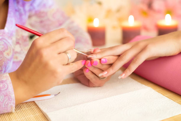 manicure process in beauty salon - deposition stock pictures, royalty-free photos & images