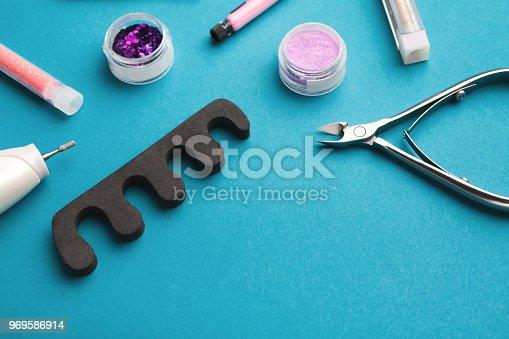 1169941952istockphoto Manicure supplies on blue background 969586914