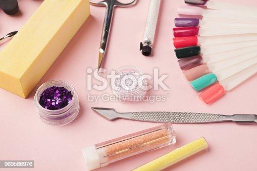 1169941952istockphoto Manicure supplies on pink background 969586976