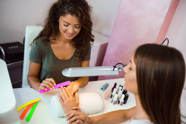 Manicure treatment in a beauty salon stock photo