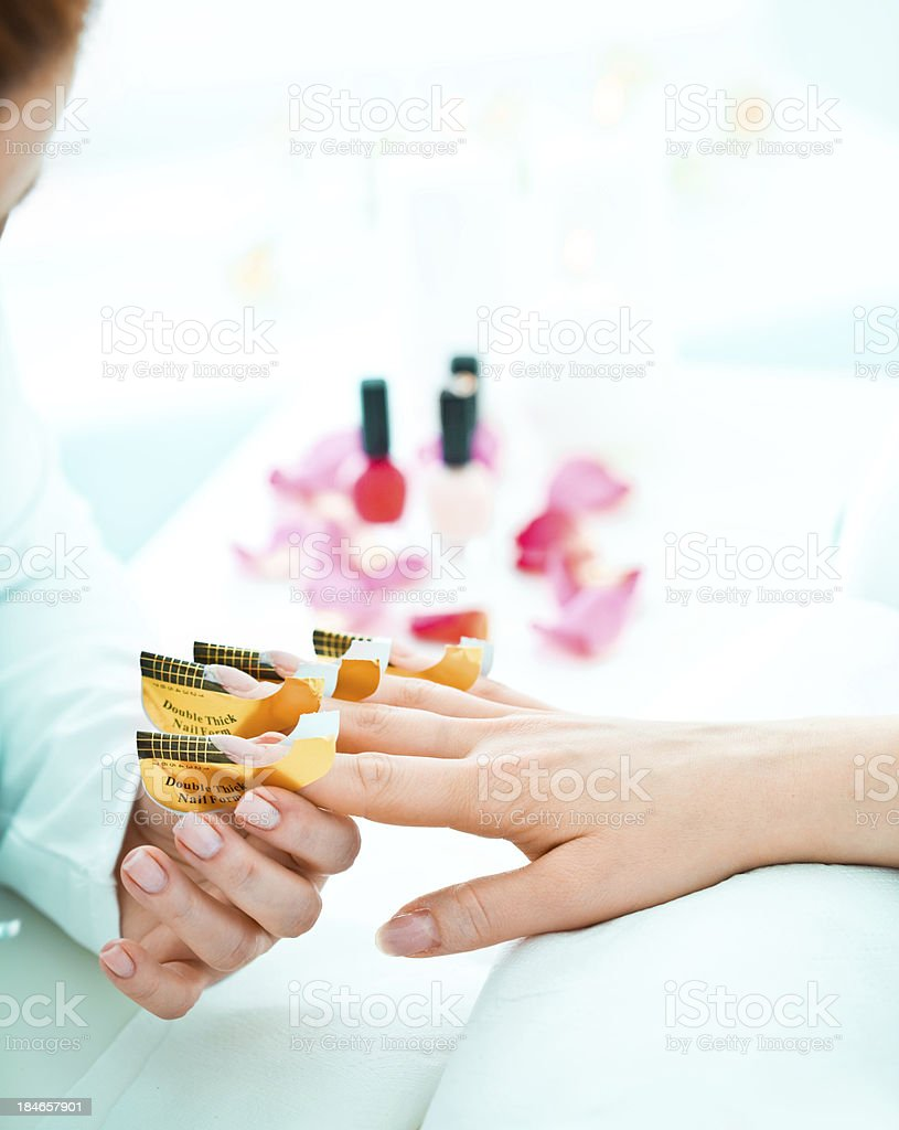Manicure treatment in nail salon royalty-free stock photo