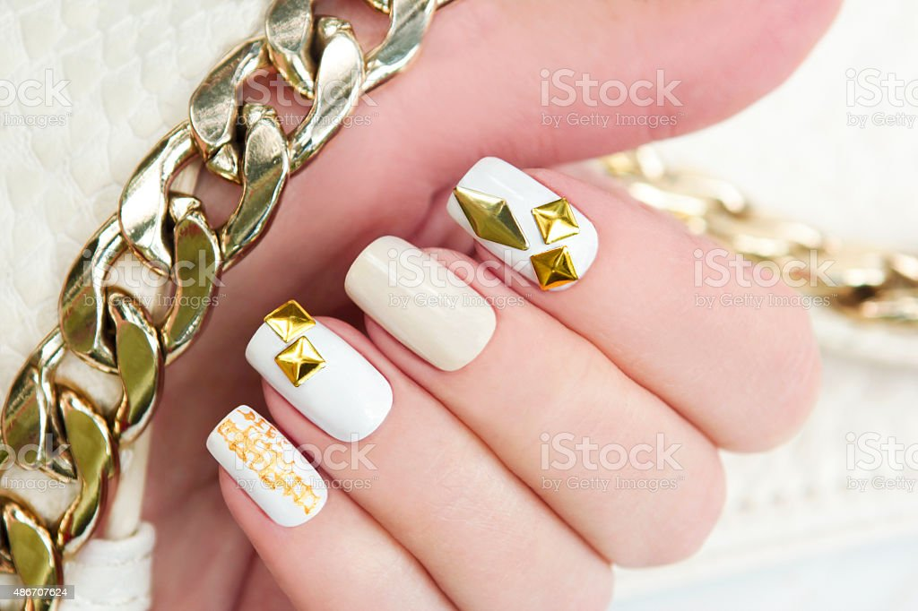 Manicure with gold. stock photo