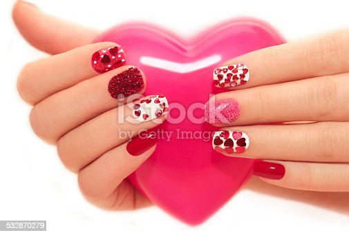istock Manicure with hearts 532870279
