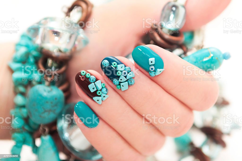 Manicure with stones of turquoise. stock photo
